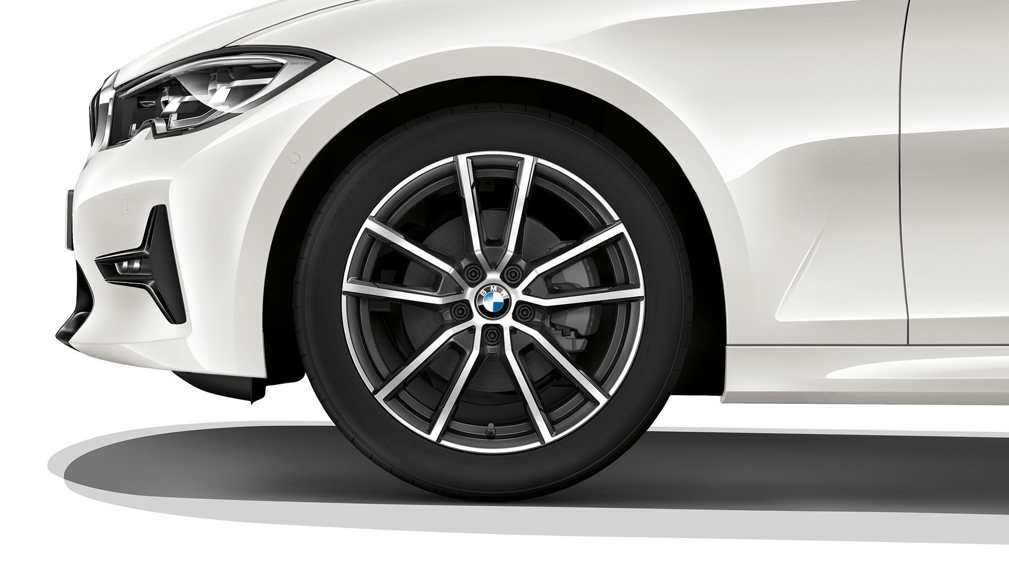 Close-up of the light alloy wheel of the BMW 3 Series Sedan with Model Sport Line equipment.