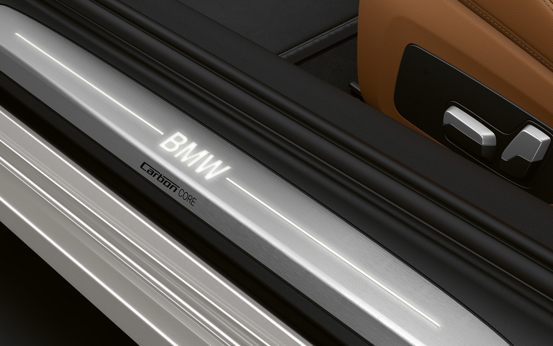 Close-up of the door sill of the BMW 8 Series Coupé with BMW logo.