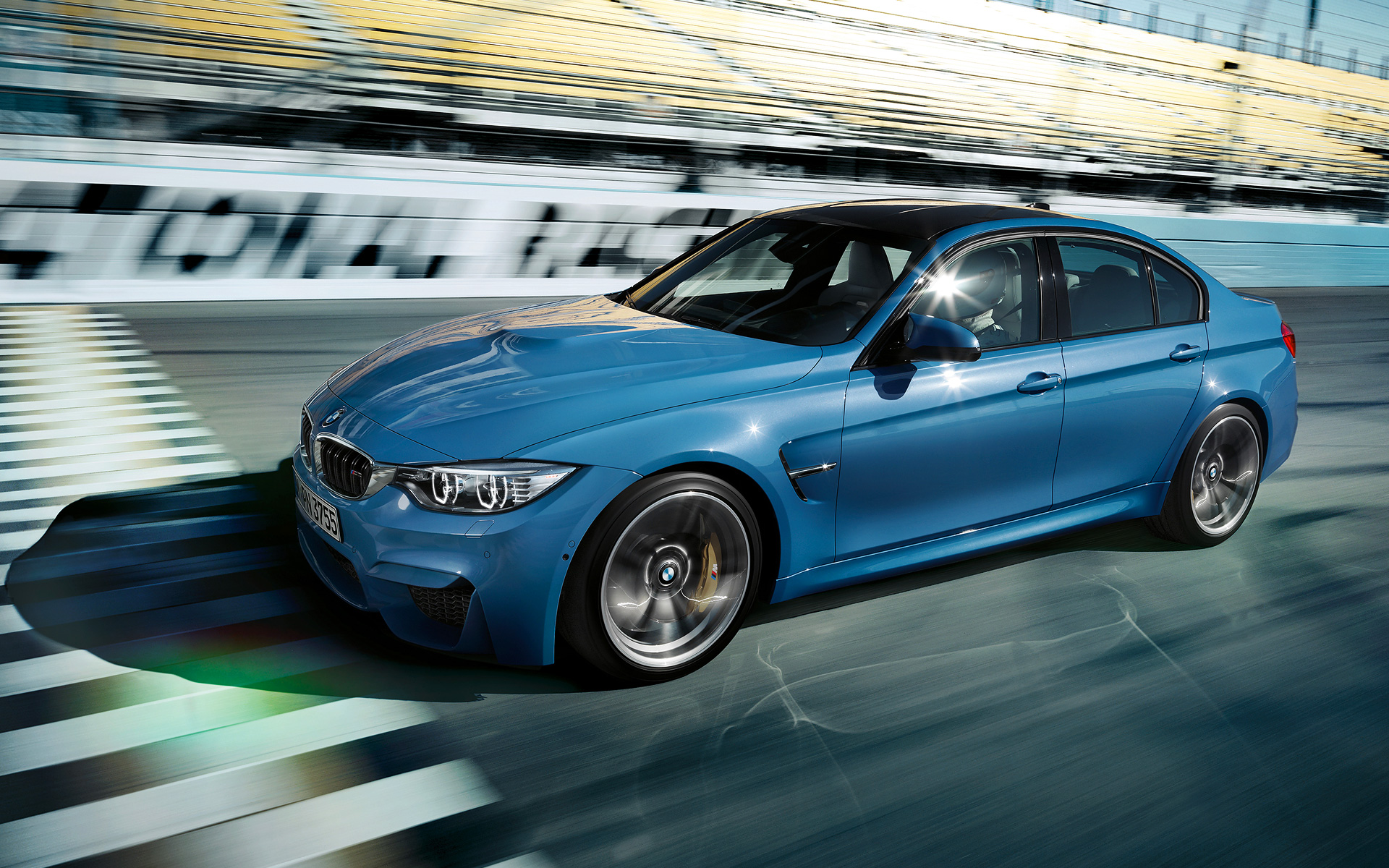 Driving BMW M3 Sedan on Track