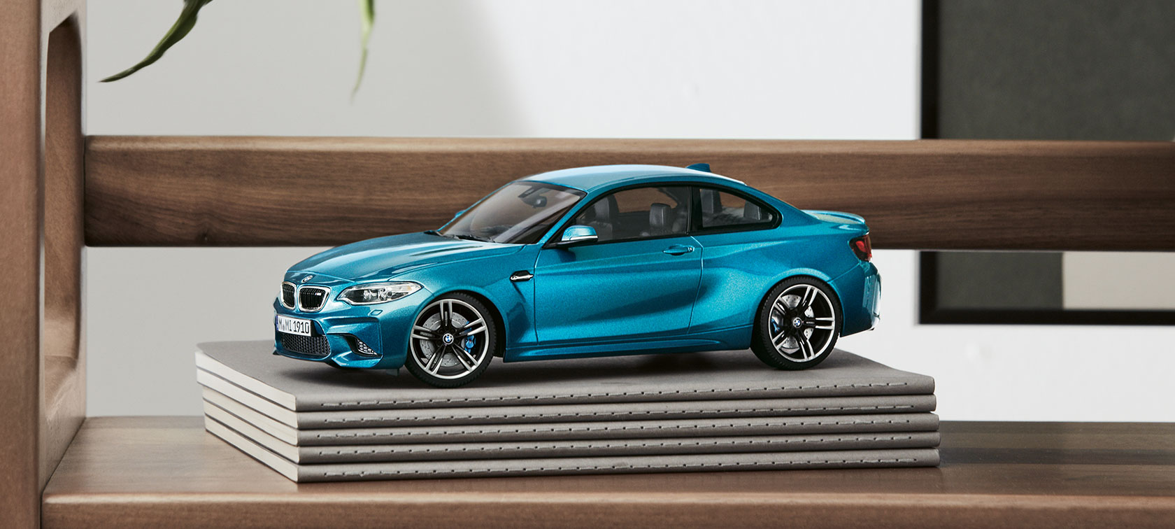 The focal point of the picture is a scale model from the BMW Miniatures Collection.